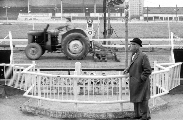 A tractor passes the finish line as it racks the track