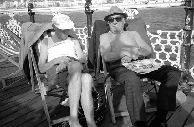 Sunbathers on Brighton Pier