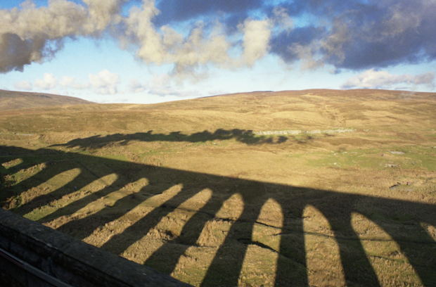 The Cumbrian Mountain Express passing over the Ribblehead Viaduct.